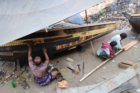 A man fixing his boat
